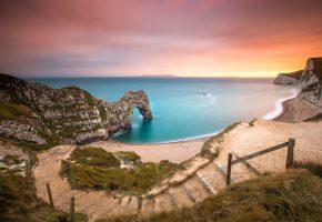 Обои скалы, море, берег, песок, арка, закат, пейзаж