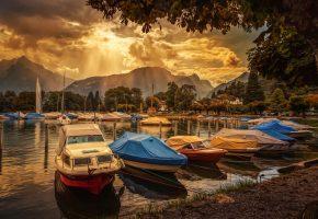Обои Швейцария, озеро, лодка, горы, облака, лучи